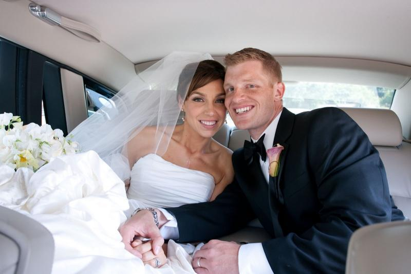 couple in wedding limo